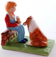 Little girl and collie dog figurine