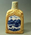 carved blue and white bottle